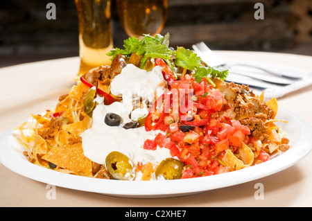 fresh nachos and vegetable salad with meat ,chili con carne ,tipycal mexican food - Stock Photo