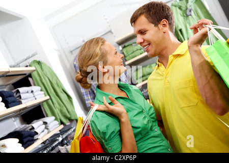 A young couple shopping together in supermarket - Stock Photo