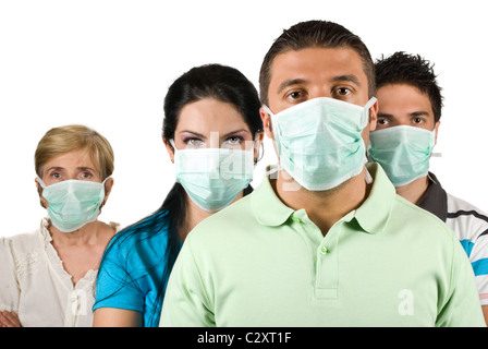 Portrait of few people group standing straight and wearing protective mask trying to protect them from flu epidemic - Stock Photo
