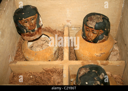 Wooden Chest Containing Canopic Jars - Stock Photo