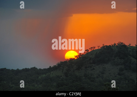 Sun setting behind Boma National Park hills, Boma-Jonglei State, South Sudan - Stock Photo