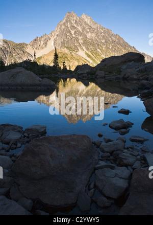 Mount Stuart reflected in still water of Ingalls Lake Central Cascades Washington USA - Stock Photo