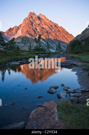 Mount Stuart reflected in a small pond near  Ingalls Lake in the Central Cascades Washington USA - Stock Photo
