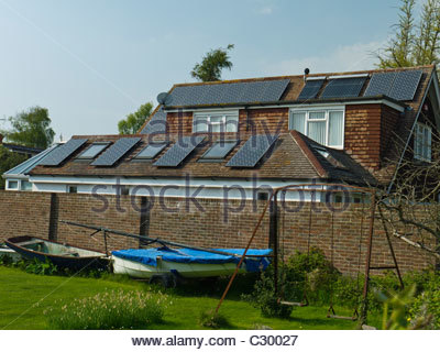 England ,UK Hampshire Solar Panels on House Roof Energy Power Electricity Hot Water - Stock Photo