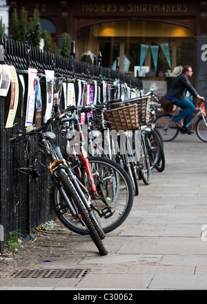 A row of parked bicycles in Cambridge, UK - Stock Photo