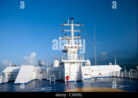 Communication  mast on the upper deck of a Greek ferry sailing on the Aegean Sea. - Stock Photo