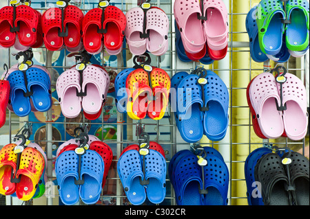 Beach shoes on sale at general store selling seaside products in Aberdyfi, Aberdovey, Snowdonia, Wales - Stock Photo