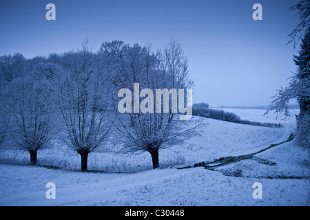 Traditional snow scene in The Cotswolds, Swinbrook, Oxfordshire, United Kingdom - Stock Photo