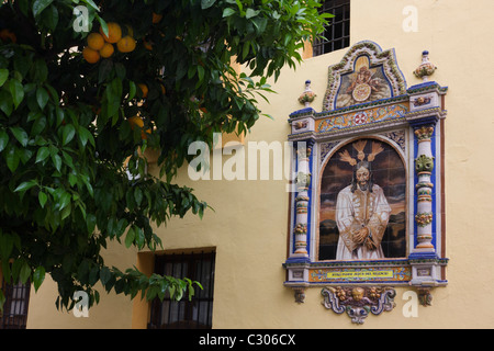Andalucian ceramic tiling of Jesus Mary on a church wall in Seville. - Stock Photo