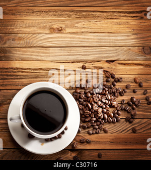 Cup of coffee. View from above on a wooden surface. - Stock Photo