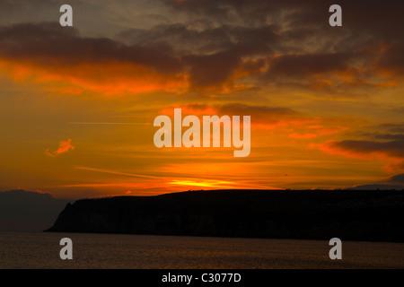 Sunset over Beer Head in Devon - Stock Photo