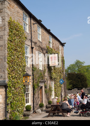 Customers enjoying the sunshine outside the Rose and Crown Hotel in Romaldkirk Co. Durham - Stock Photo