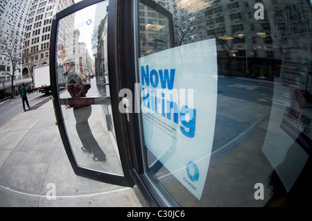 A Now Hiring sign in the window of a JP Morgan Chase branch in Lower Manhattan on Friday, April 15, 2011. (© Frances - Stock Photo