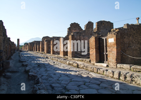 A street in ruined city of Pompeii, Italy - Stock Photo