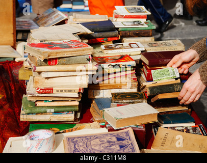 Secondhand books on stall in famous street market in calle Ferria, in barrio Macarena, Seville, Spain, Europe - Stock Photo
