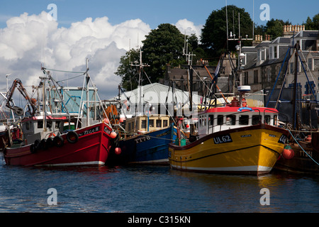 Fishing boats tied up at the dockside in the small fishing port of Tarbert, Loch Fyne. - Stock Photo