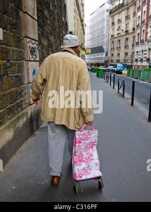 Paris, France, Senior Man Walking Away on Street with Shopping Cart - Stock Photo