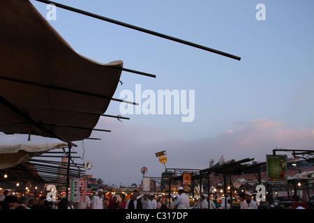 the popular Jamaa el-Fnaa square at dusk - Stock Photo