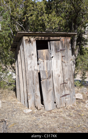 A leaning outhouse is one of the features to be found, and used, by the adventurous traveler to the Hondo Valley, - Stock Photo