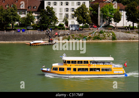 An events ship - Basel - with traditional ferry in the background - Stock Photo