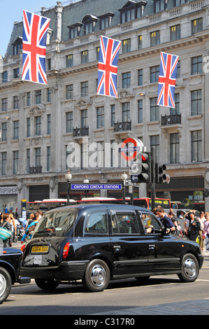 London black cab taxi at Oxford Circus station - Stock Photo