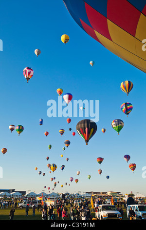 Watching the mass ascension from the balloon grounds at the Albuquerque Hot Air Balloon Festival (Fiesta), New Mexico, - Stock Photo