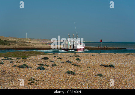 Fishing boat leaving Rye Harbour East Sussex England UK - Stock Photo