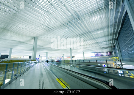 China; Hong Kong international airport main hall; the words in the label is be care of children - Stock Photo