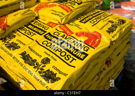 Bags pile Cavering horse manure compost - Stock Photo