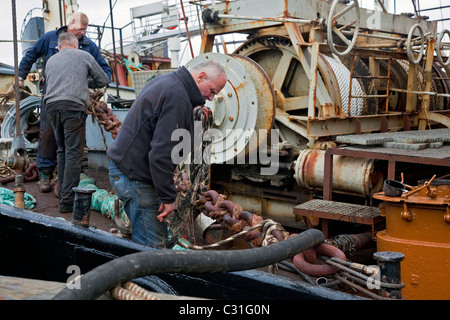 WHALE FISHING, THE CREW OF ONE OF KRISTJAN LOFTSSON'S WHALERS READY TO CAST OFF FROM THE PORT OF REYKJAVIK, ICELAND, - Stock Photo