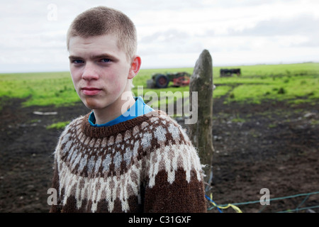 YOUNG ICELANDIC FARMER ON THE SOUTHERN COAST OF ICELAND, EUROPE - Stock Photo