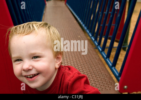 A happy toddler playing at a playground in Alameda, CA - Stock Photo