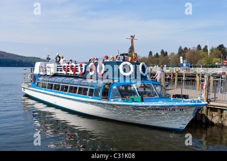 Tourists on an excursion boat in Bowness, Lake Windermere, Lake District National Park, Cumbria, UK - Stock Photo