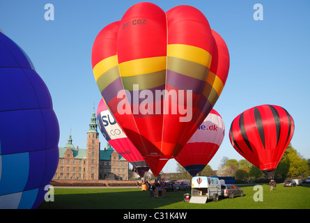 Hot air balloons ready to ascend from the grounds of Rosenborg Castle, the King's Garden in Copenhagen - Stock Photo