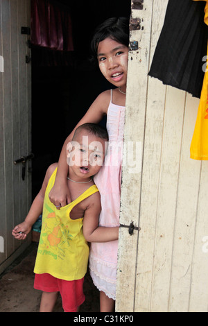 BURMESE CHILD MADE UP WITH THANAKA, A PASTE MADE FROM GRATED BARK, KAWTHAUNG, MYANMAR, SOUTHERN BURMA, ASIA - Stock Photo