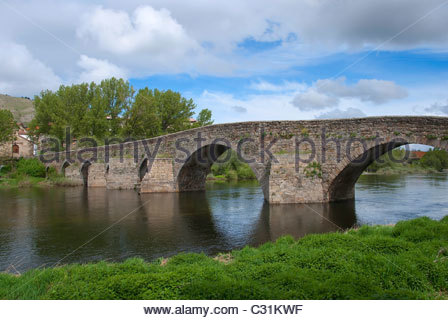 Old bridge over tormes river in Barco de Avila. Avila. Spain. Romanesque style - Stock Photo