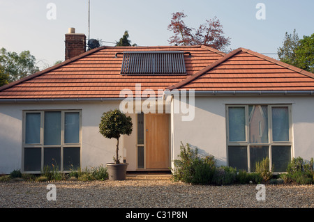 Bungalow fitted with evacuated solar energy tubes for hot water system - Stock Photo