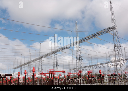Part of High Voltage Station against blue sky and clouds - Stock Photo