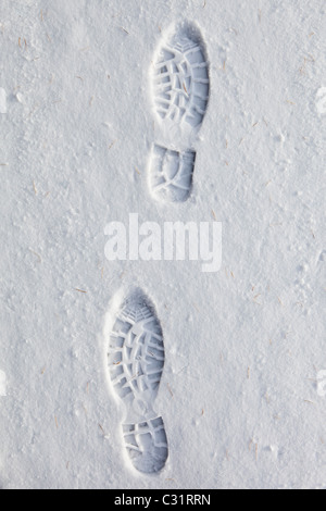 Footprints in the snow in frosty wintry landscape in The Cotswolds, Oxfordshire, UK - Stock Photo