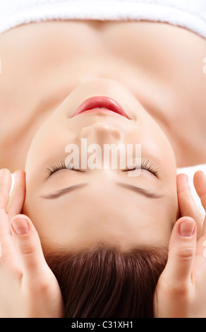 Face of pretty female during procedure of facial massage - Stock Photo