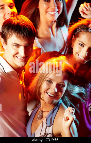 Image of attractive young people having fun at disco - Stock Photo