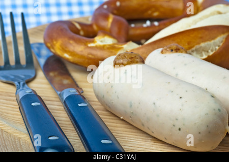 veal sausage with pretzel and sweet mustard - Stock Photo