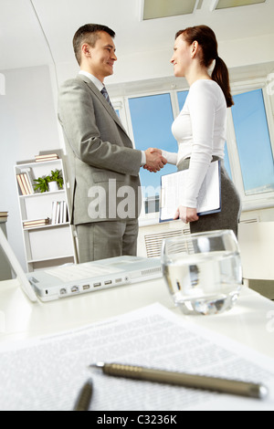 Photo of business partners handshaking after making agreement in office - Stock Photo