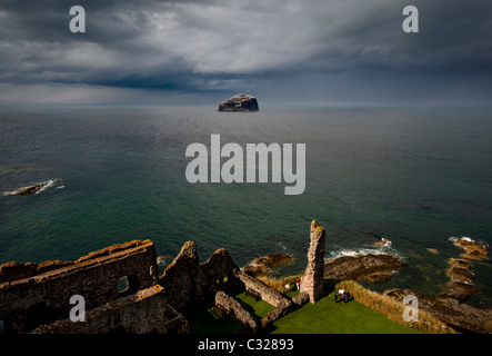 Bass Rock viewed from Tantallon castle on the East Lothian coast of central Scotland - Stock Photo