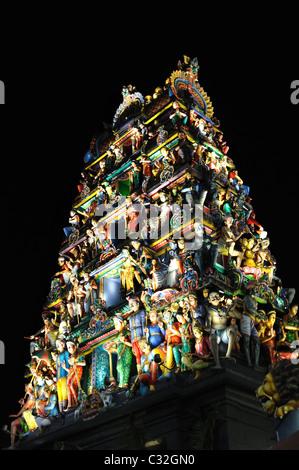 Tehnicolour 1930s gopuram above entrance to Sri Mariamman Temple - Stock Photo