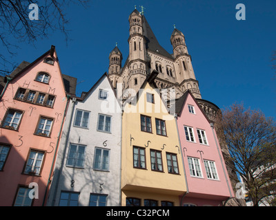 Gross St Martin Church and historic coloured houses in FischMarkt or Fish Market in Cologne Germany - Stock Photo