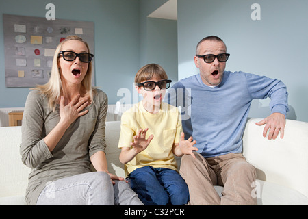 Family watching 3d movie at home - Stock Photo