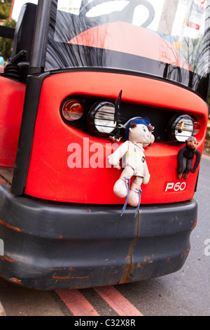 Child's toy stuck to the front of an electric vehicle used at St George's Hospital. Tooting, London - Stock Photo