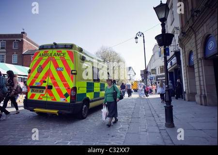 Ambulance parked on a busy main street in Chesterfield - Stock Photo