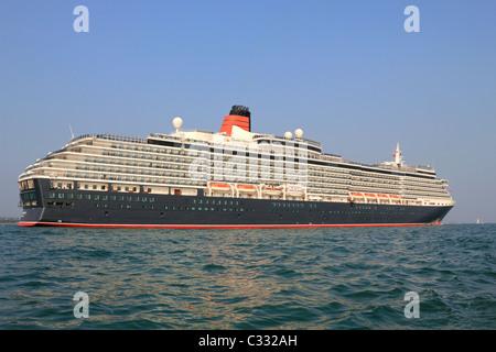 Queen Victoria Cunard cruise ship in Southampton Water, Hampshire, England UK - Stock Photo